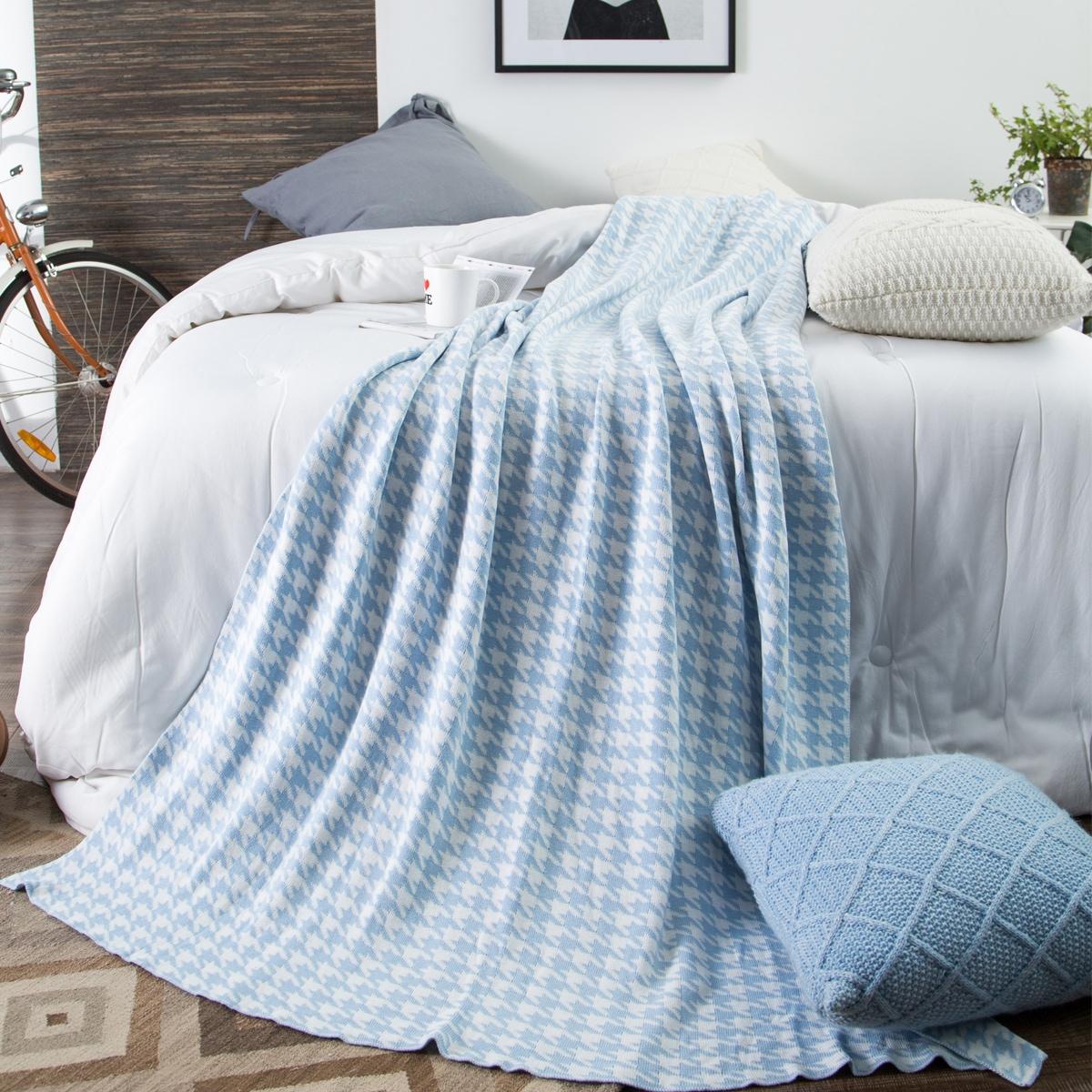 Couverture tricotée à motif pied-de-poule