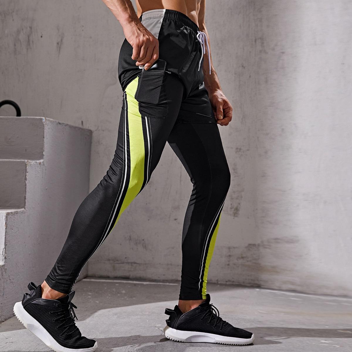 Medias deportivas de cintura con cordón 2 en 1 panel en contraste con bolsillo de celular