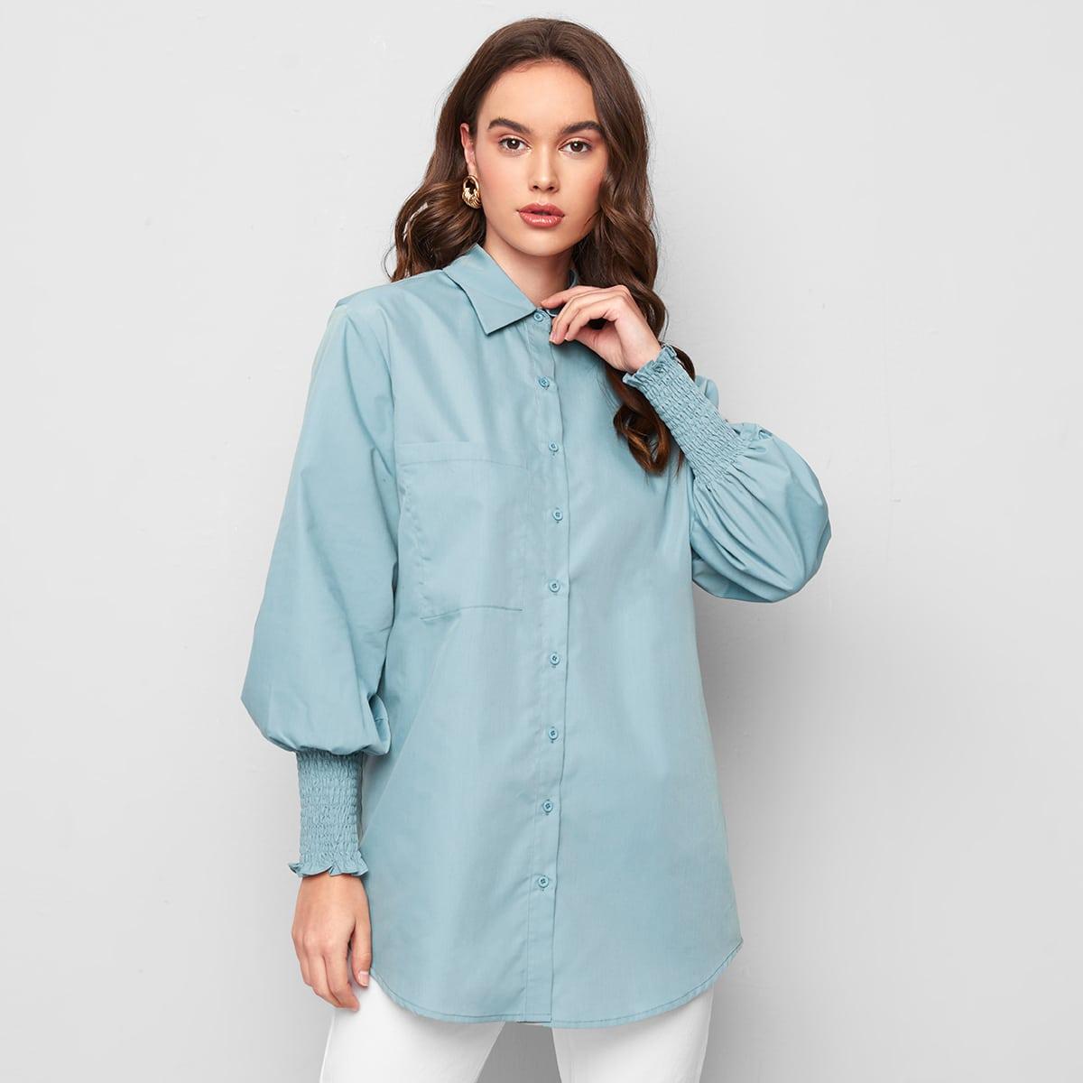 Bluse mit Laternenärmeln und gebogenem Saum