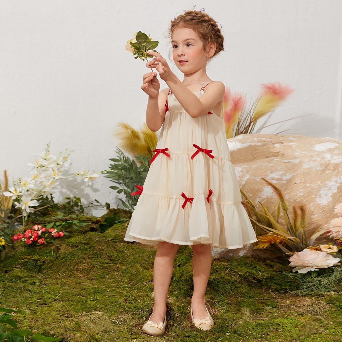 Платье на бретелях с бантом  для девочек по цене 651