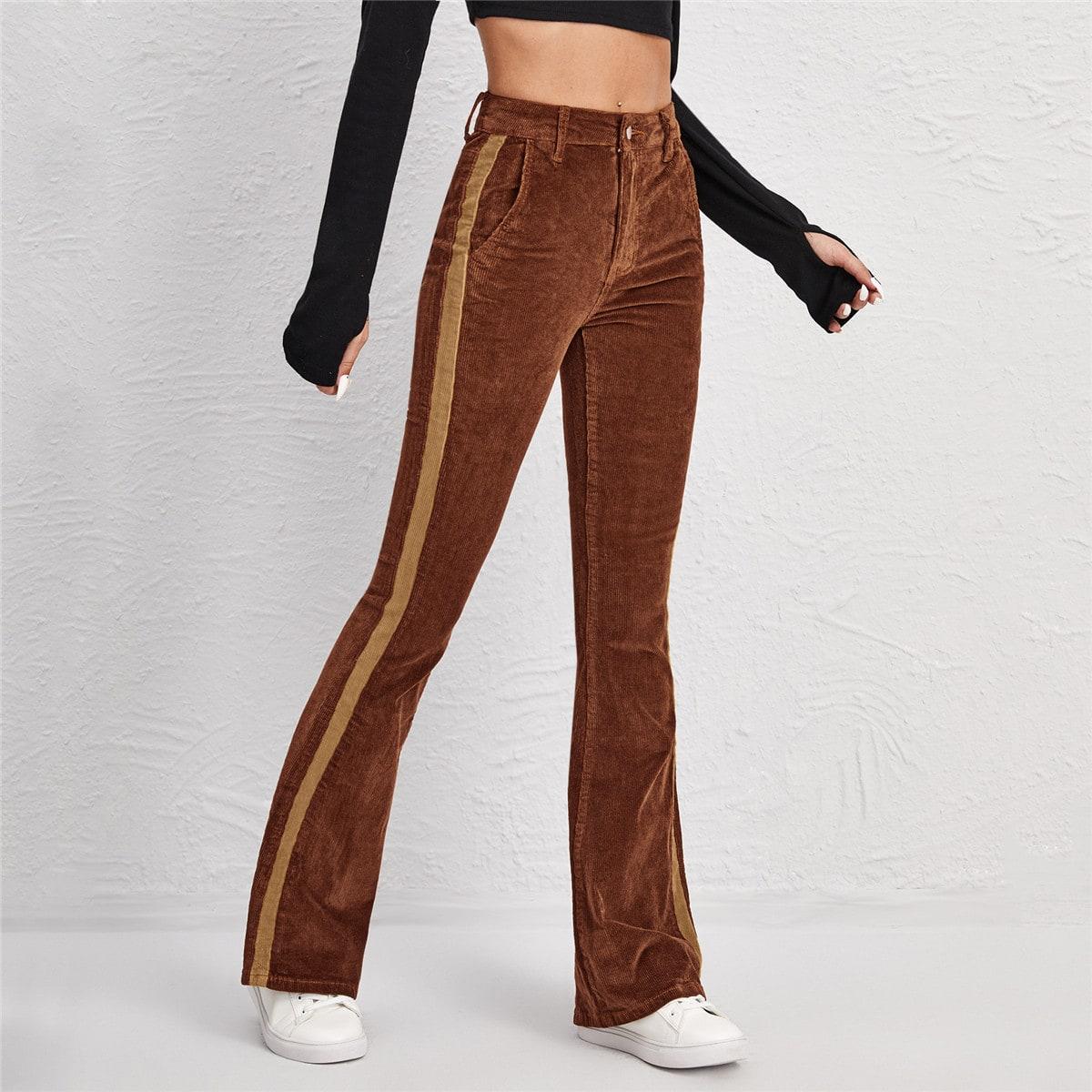 Вельветовые расклешенные брюки с высокой талией по цене 1 640