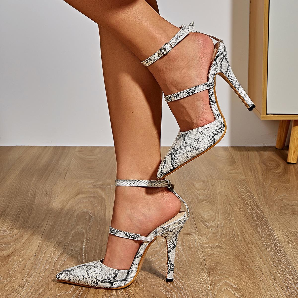 Туфли-лодочки на высоком каблуке со змеиным принтом по цене 1 790