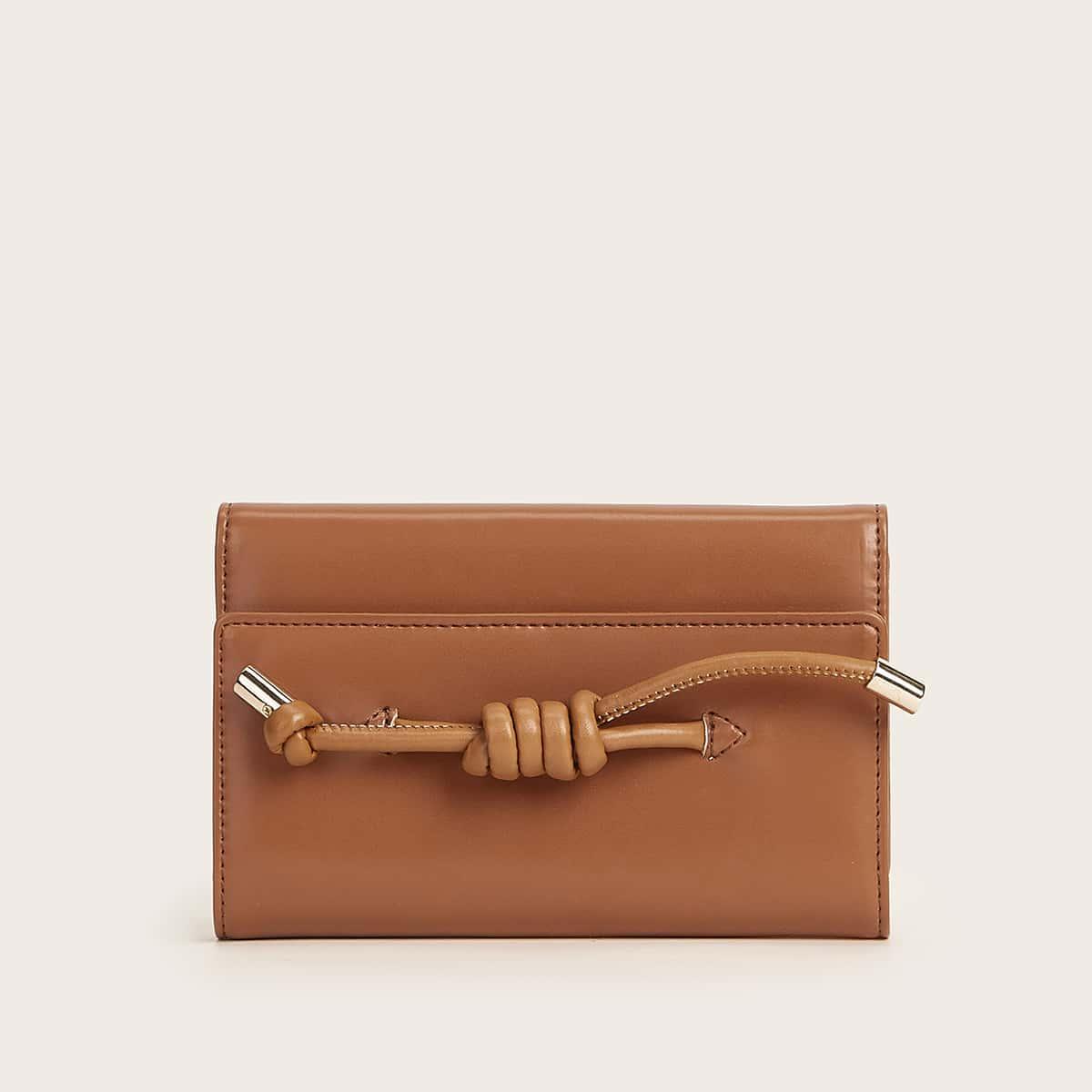 Сложенная сумка с узлом