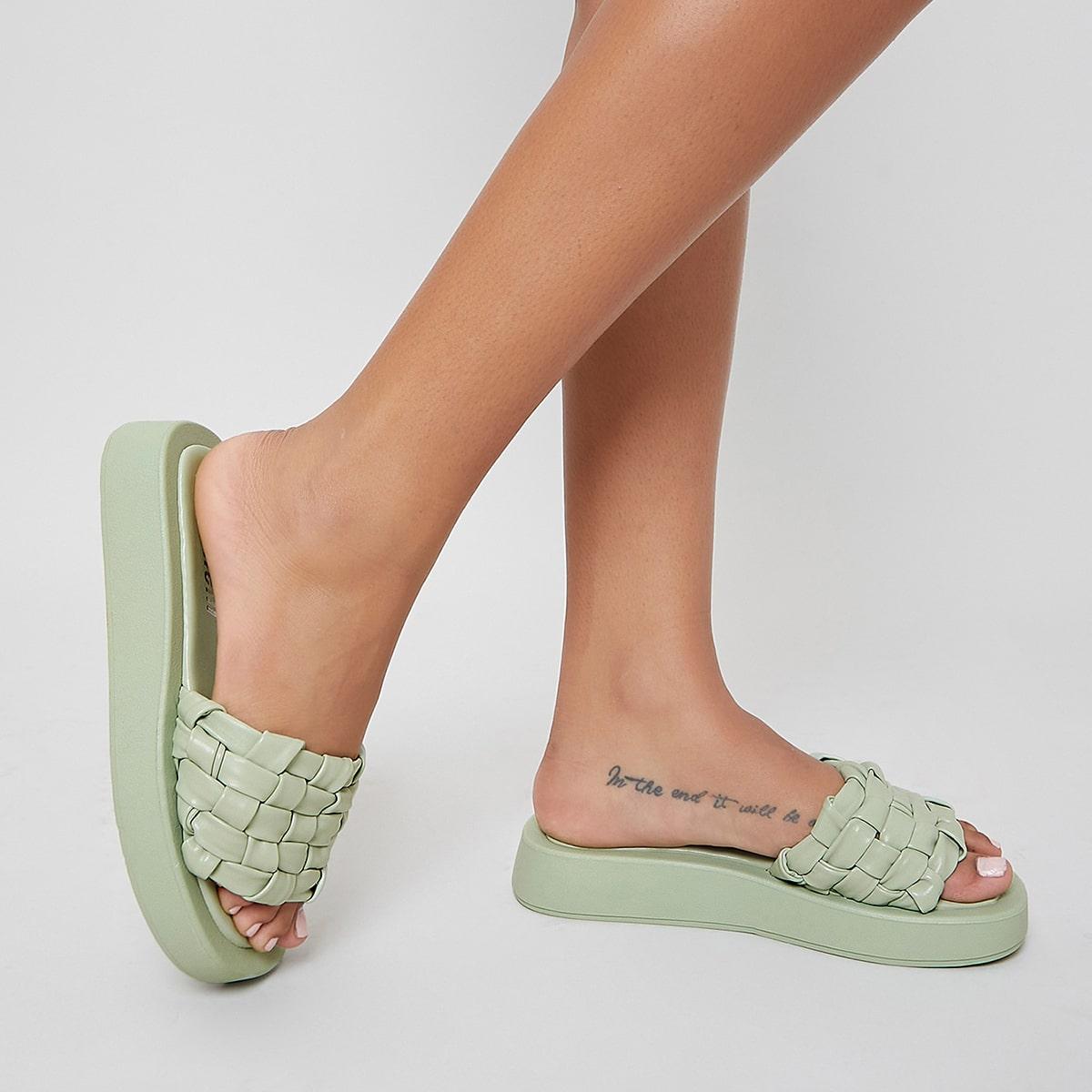 Sandalias de plataforma con tira tejida de cuero vegano