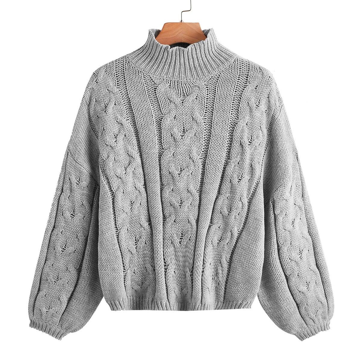 Suéter tejido de cable de cuello alto