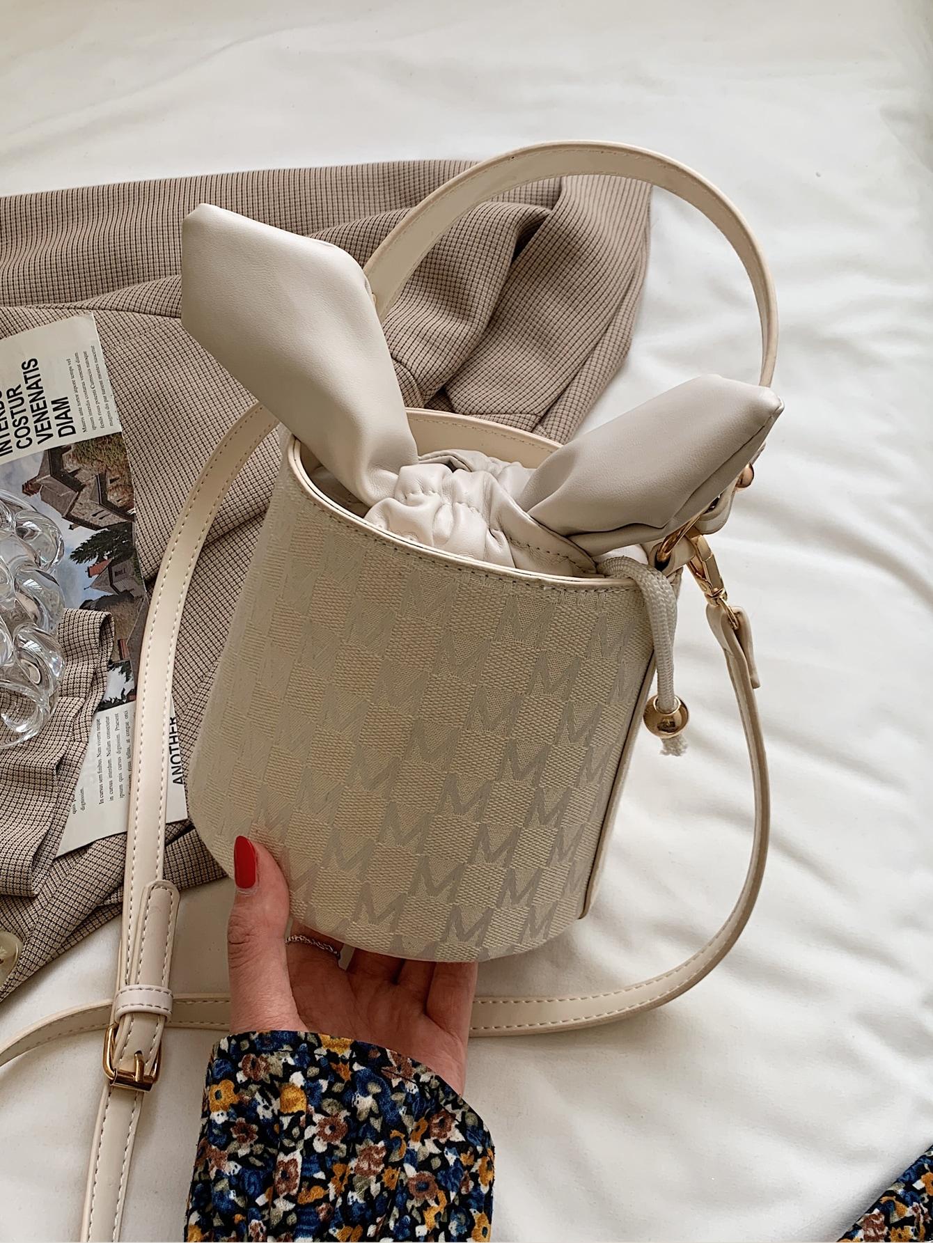 letter graphic drawstring satchel bag