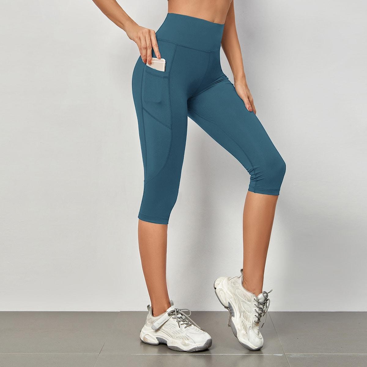 Leggings deportivos capri unicolor con bolsillo de móvil