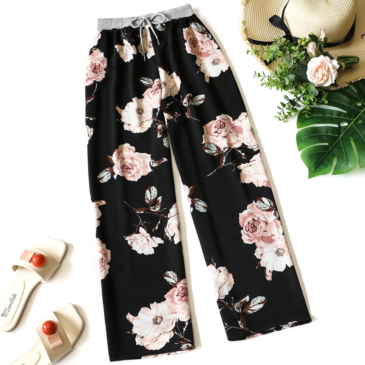 Pantalones rectos con estampado floral con nudo delantero
