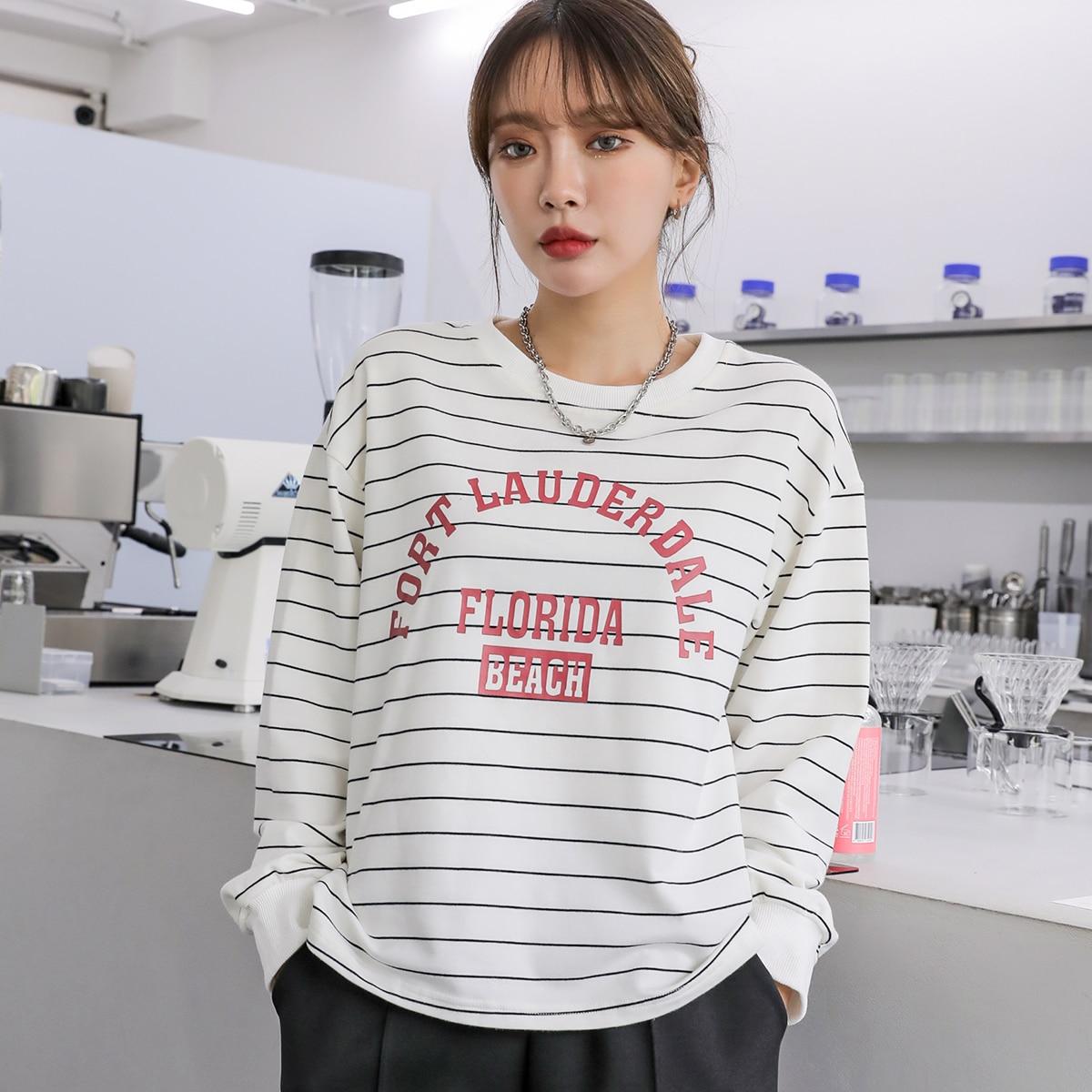 Пуловер в полоску с текстовым принтом