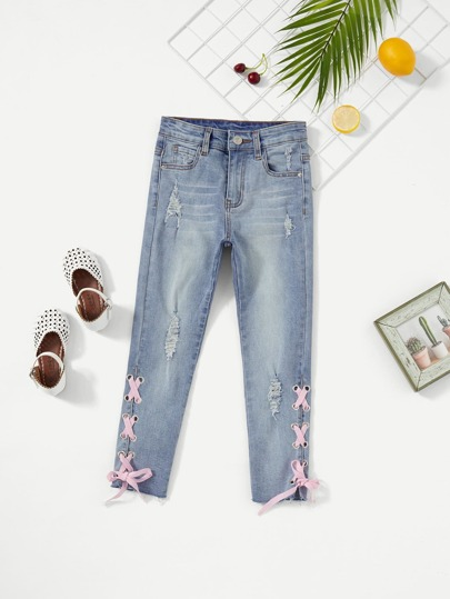 51ccac0ab79 Girls Grommet Lace Up Ripped Jeans