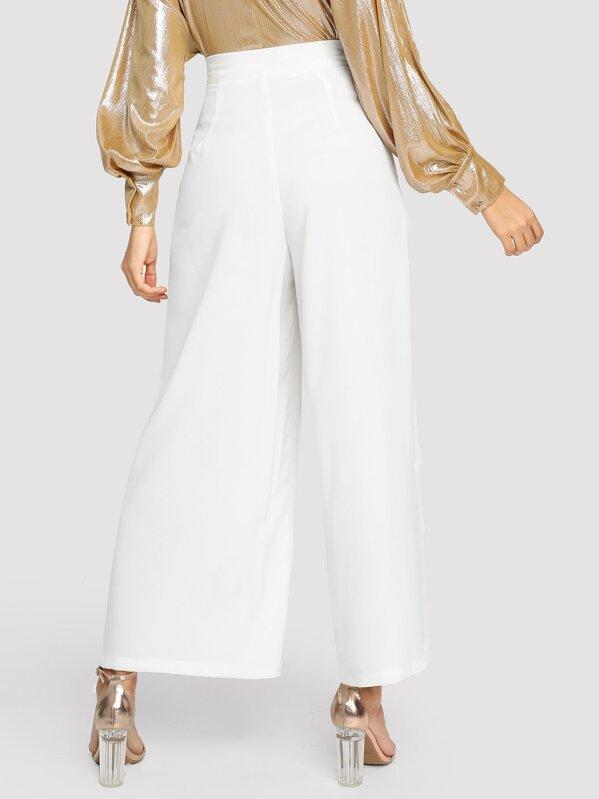 Pantalones anchos con bolsillo oblicuo de cintura alta  1651193932d