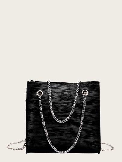 9c5144c8992 Bolsa de mano con cadena con textura