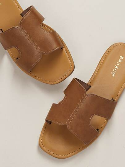 87112f320 Wide Band Dual Cut Out Slide Sandals